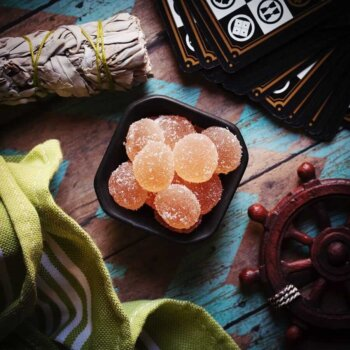 Passion Fruit CBD Gummies on table